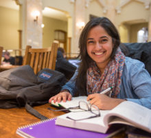 Student studying at Carnegie Library Reading Room